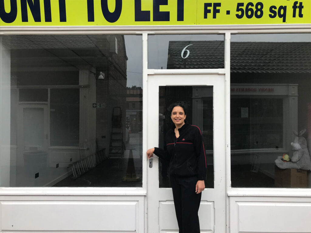 Photo of Ripon Postmistress Amy Kaur outside the new premises in The Arcade
