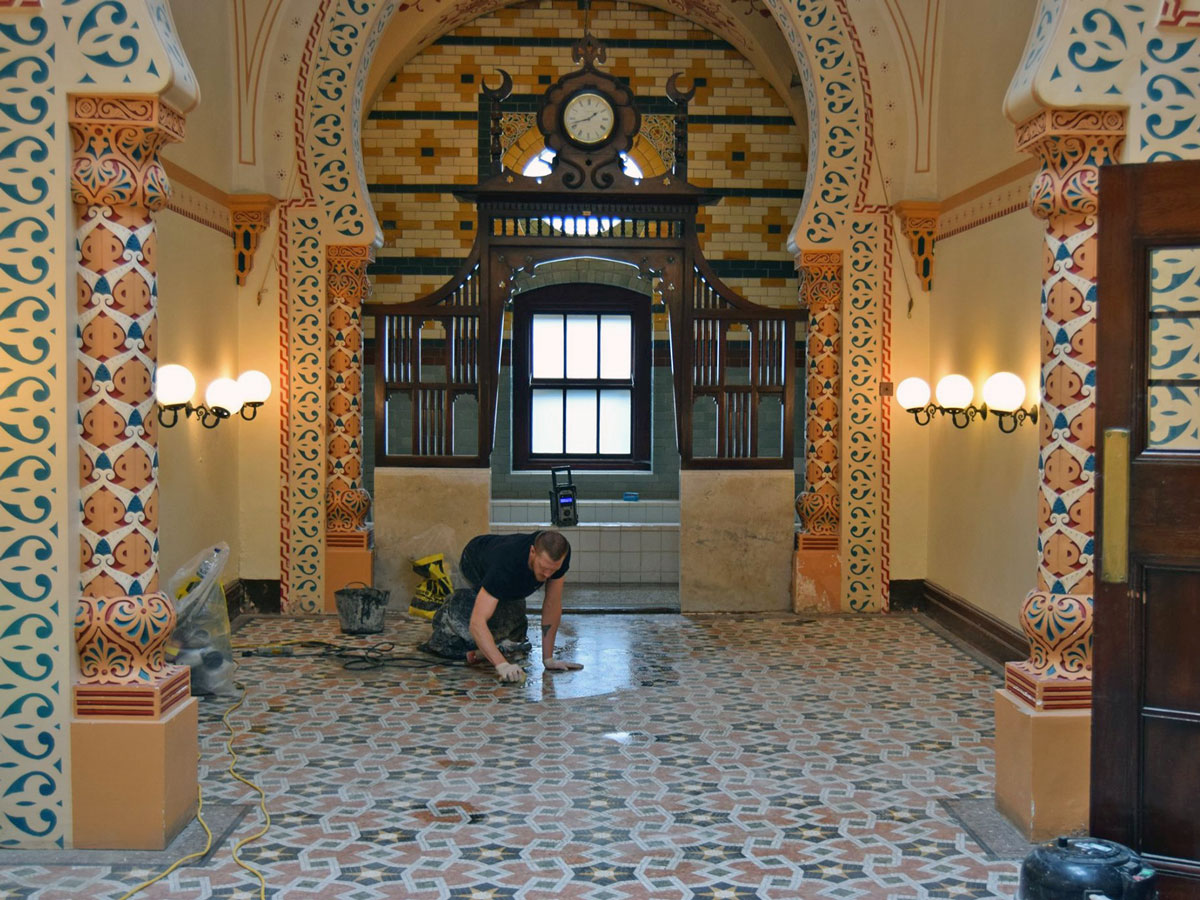 Cleaning the tiles at Turkish Baths