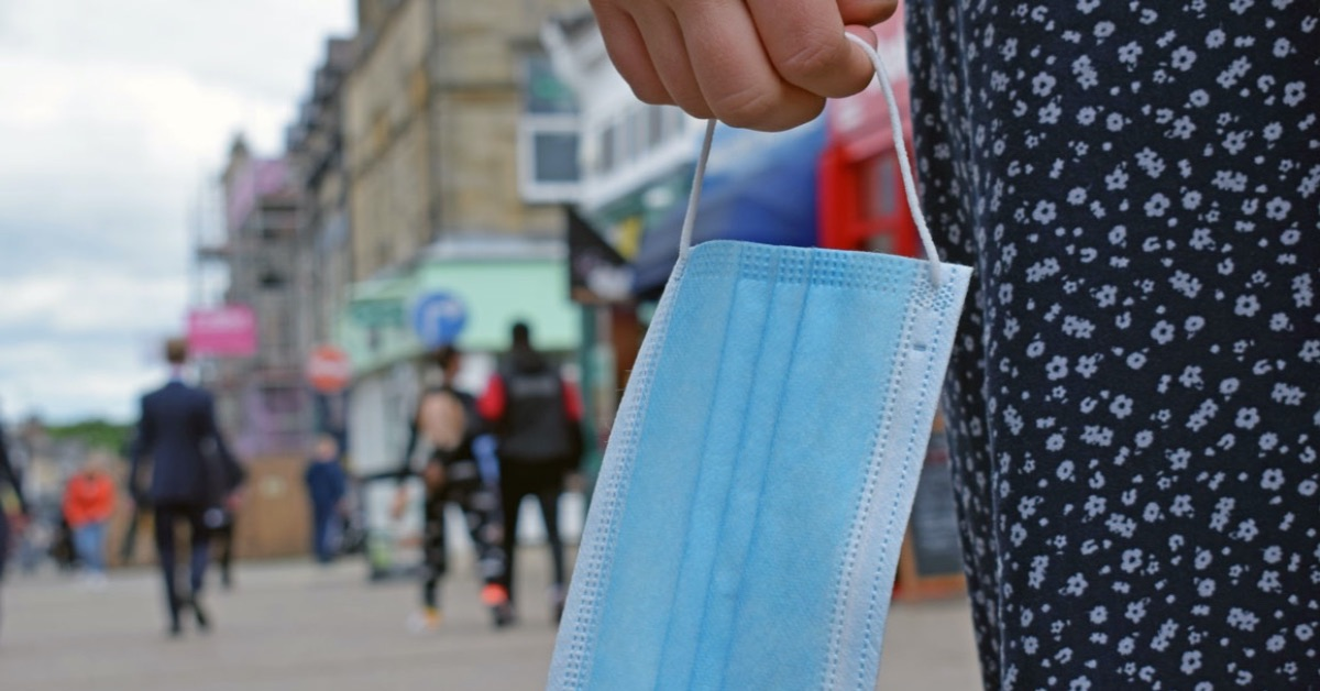 People urged to respect businesses' wishes as face mask order dropped