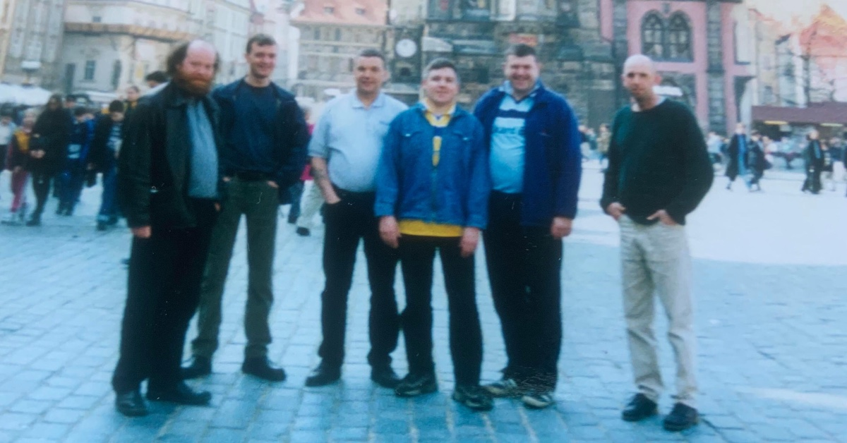 Dave Rowson (centre) in the Town Square in Prague during Leeds United European campaign.