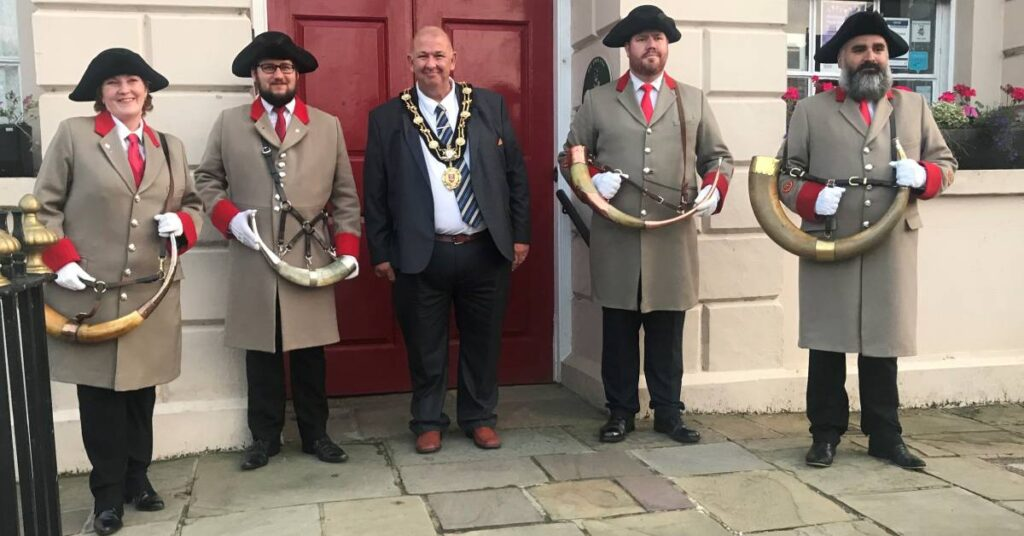 Photo of the Mayor of Ripon with the city's hornblowers
